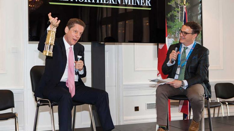 Robert Friedland, executive chairman of Ivanhoe Mines, hoists his Lifetime Achievement Awards at the The Northern Miner's 2017 Canadian Mining Symposium in London, United Kingdom. Photo by The Northern Miner.