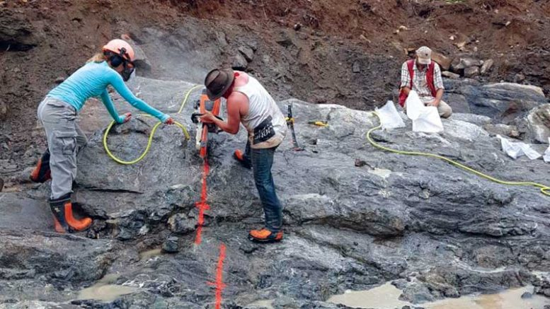 Workers cutting a channel at Mitchi. Credit: Kintavar Exploration.
