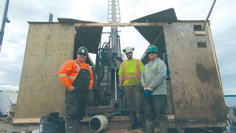 Workers on a drilling barge at Fission Uranium's Patterson Lake South uranium project in northern Saskatchewan. photo by Richard Quarisa.