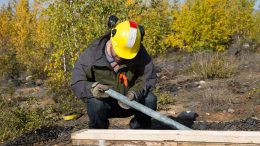 Nighthawk staff inspecting core samples at the Indin Lake gold property. Credit: Nighthawk.