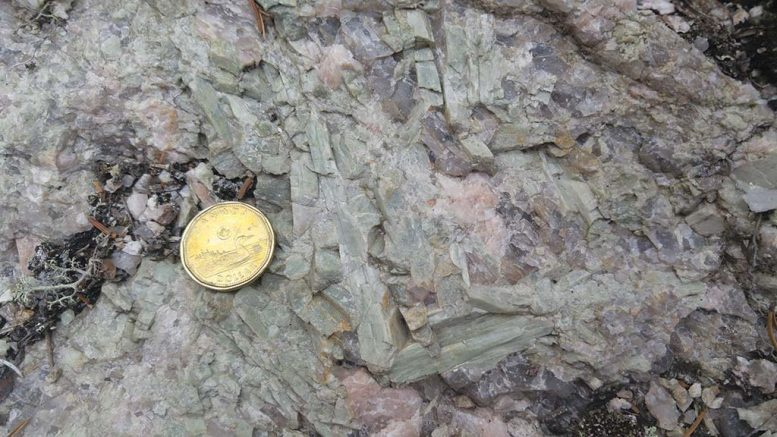 Small green spodumene blades in pegmatites at New Age Metals' Lithium Two lithium project. Credit: New Age Metals.