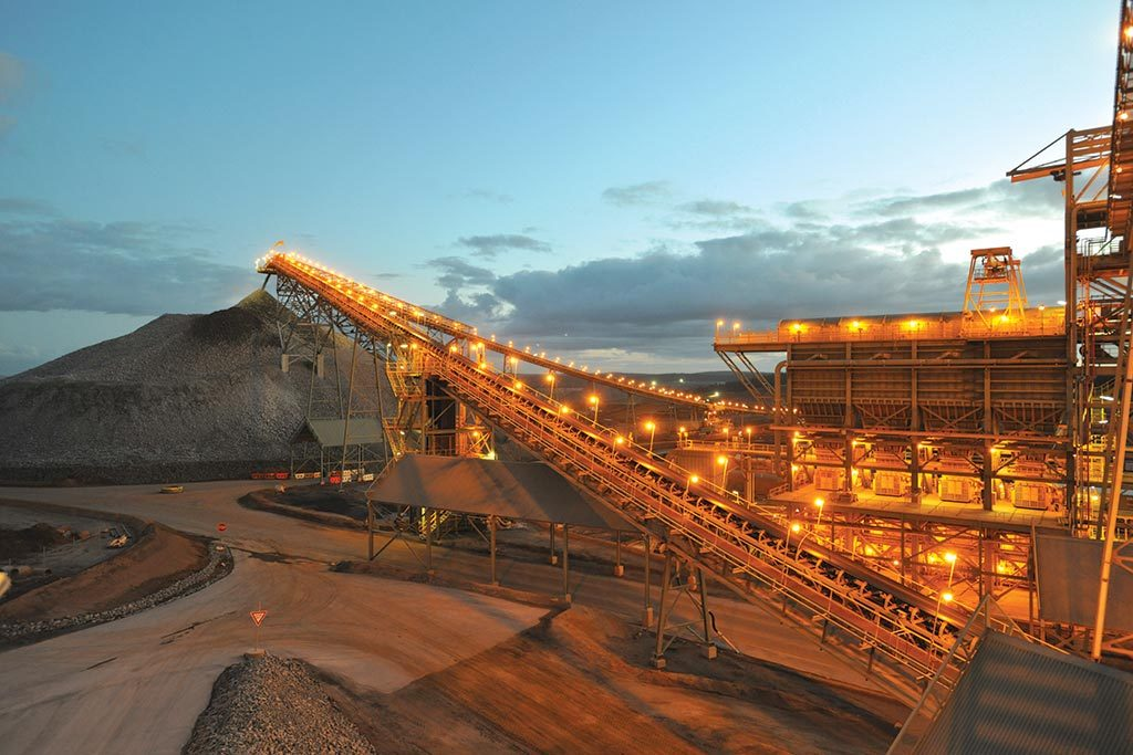 Crushed ore falls off a conveyor at Newmont Mining's Boddington gold mine in Western Australia. Credit: Newmont Mining.