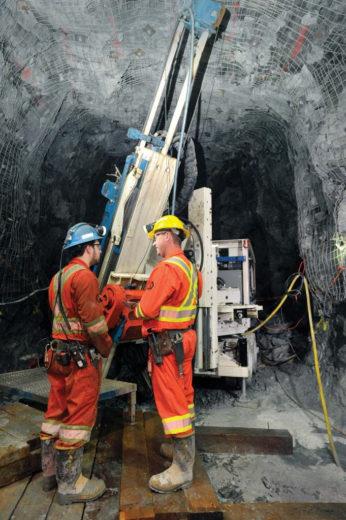 Workers operating an Orbit Garant's computerized drill rig in the field. Credit: Orbit Garant.