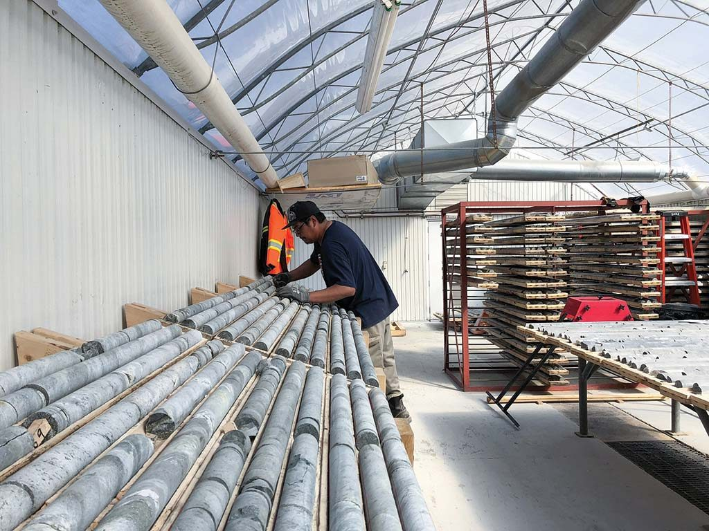 A worker in the core shack at the Troilus gold project. Credit: Troilus Gold.