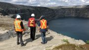 A geology team looks over the historic Z87 pit at Troilus Gold's namesake project in Quebec. Credit: Troilus Gold.
