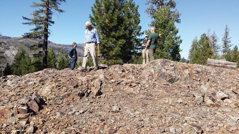 Crown Mining director George Cole (with hammer) and colleagues on an outcrop of the Moonlight copper deposit in eastern California's Plumas County. Credit: Crown Mining.