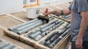A worker wets drill core from the Colomac deposit at Nighthawk Gold's Indin Lake gold project. Credit: Nighthawk Gold.