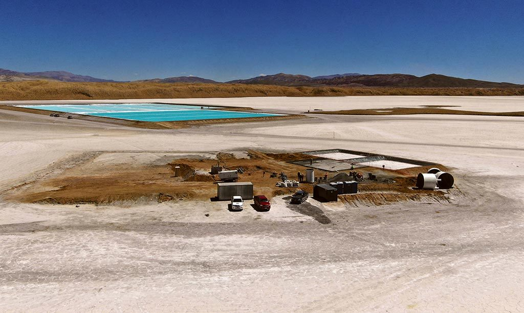 The pilot plant under construction at Pastos Grandes, with evaporation ponds in the background. Credit: Millennial Lithium.
