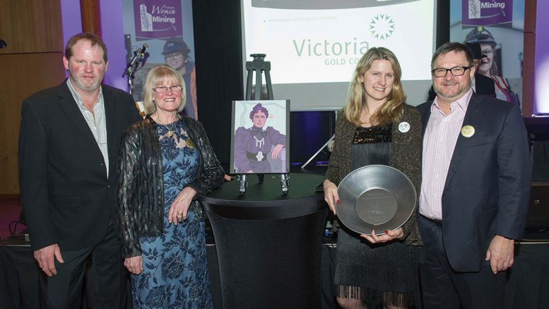 Banyan Gold president and CEO Tara Christie (holding award) accepts the Yukon Women in Mining Kate Carmack Award in 2018 for excellence in championing women within the industry, alongside (from left) her brother Seamus Christie, mother Dagmar Christie and husband John McConnell. Credit: Yukon Women in Mining.