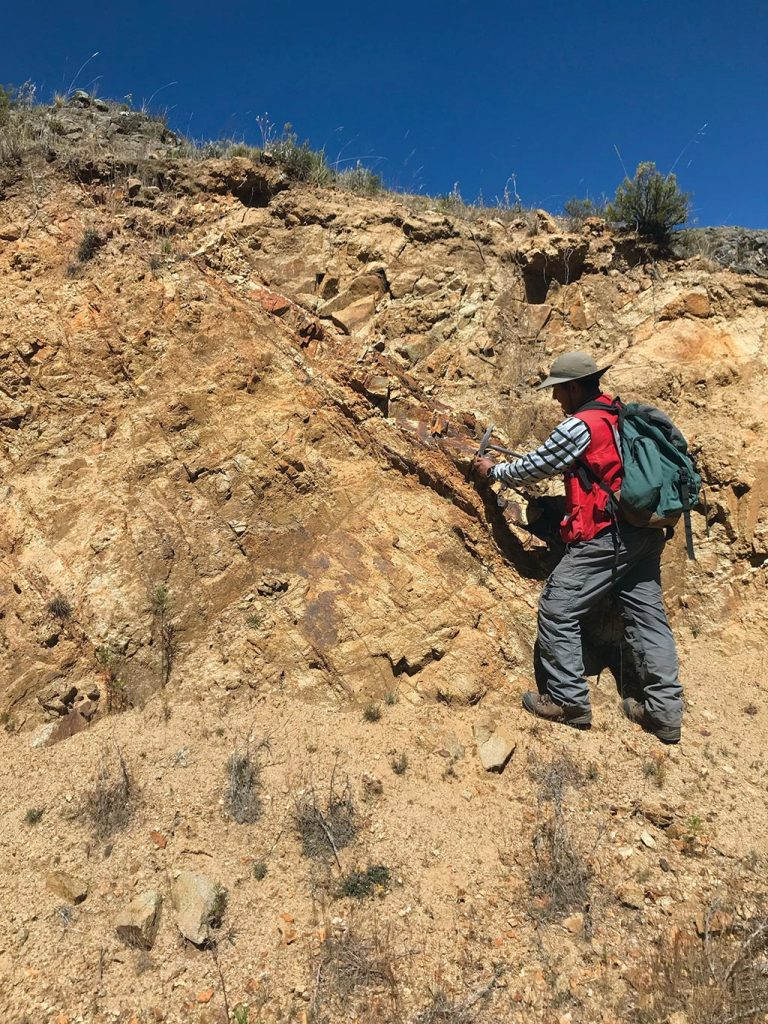A geologist collects a sample at the Totora target on Auryn Resources' Sombrero copper project in Peru. Credit: Auryn Resources.