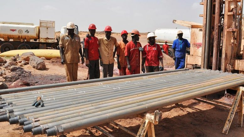 Workers pose with drill rods at Global Atomic's DASA project in Niger. Credit: Global Atomic.