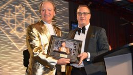 Northern Miner Group publisher Anthony Vaccaro (left) present Franco-Nevada chairman Pierre Lassonde with a memento to honour his serving as master of ceremonies at the Canadian Mining Hall of Fame's induction ceremony for the past 18 years. Lassonde was inducted into the CMHF in 2013. Going forward, Vaccaro will take up the MCing duties at the annual CMHF induction ceremony. Photo Credit: Keith Houghton Photography.