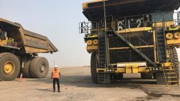 Ewan Downie — president and CEO of Thunder Bay, Ontario-based Premier Gold Mines — beside trucks at Premier's 40%-owned South Arturo gold mine in Elko County, Nevada, where majority partner Barrick Gold is operator. Credit: Premier Gold Mines.