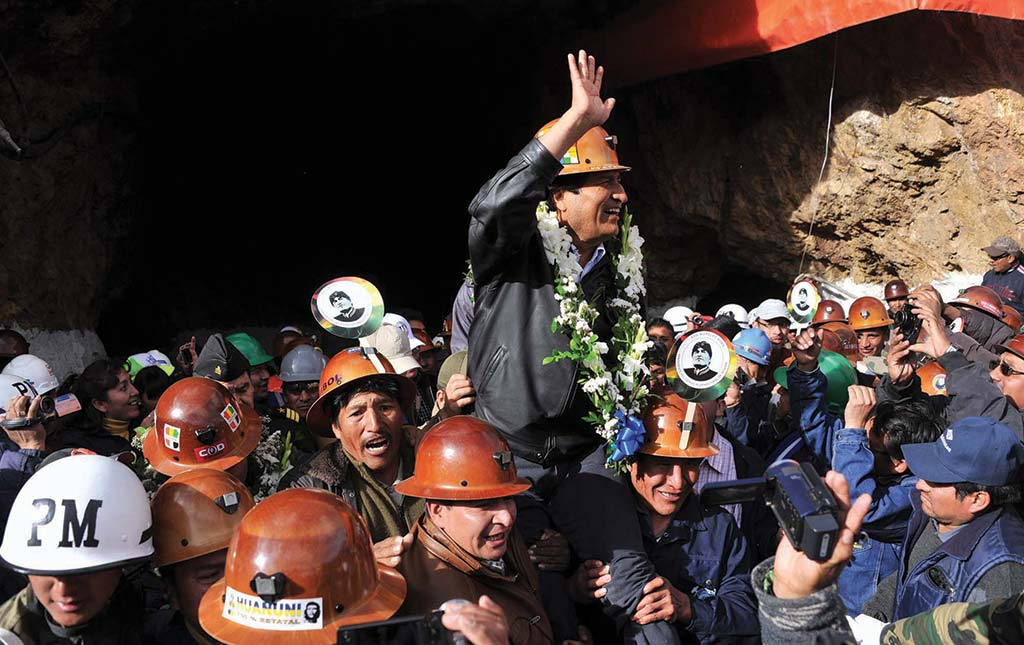 Bolivia's president Evo Morales is hoisted up after announcing a government investment in the Huanuni Mining Company in 2014. Credit: Bolivia Ministry of Communication.
