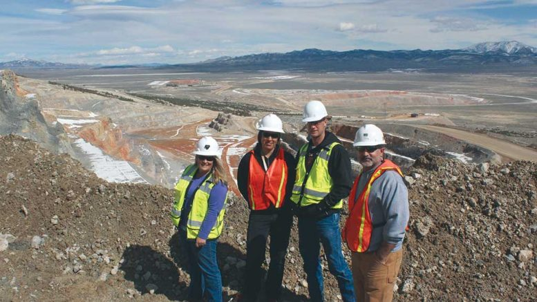 Liberty Gold's geoscience team on a visit to Newmont Mining's Long Canyon gold deposit in Nevada, from left: Moira Smith, vice-president of exploration and geoscience; April Barrios, project geologist; Randy Hannink, project geologist; and Pete Shabestari, regional geologist. Missing from the team photo: Will Lepore, project geologist. Smith was instrumental in advancing Long Canyon with Fronteer Gold before Newmont bought the company for $2.3 billion in 2011. Credit: Liberty Gold.