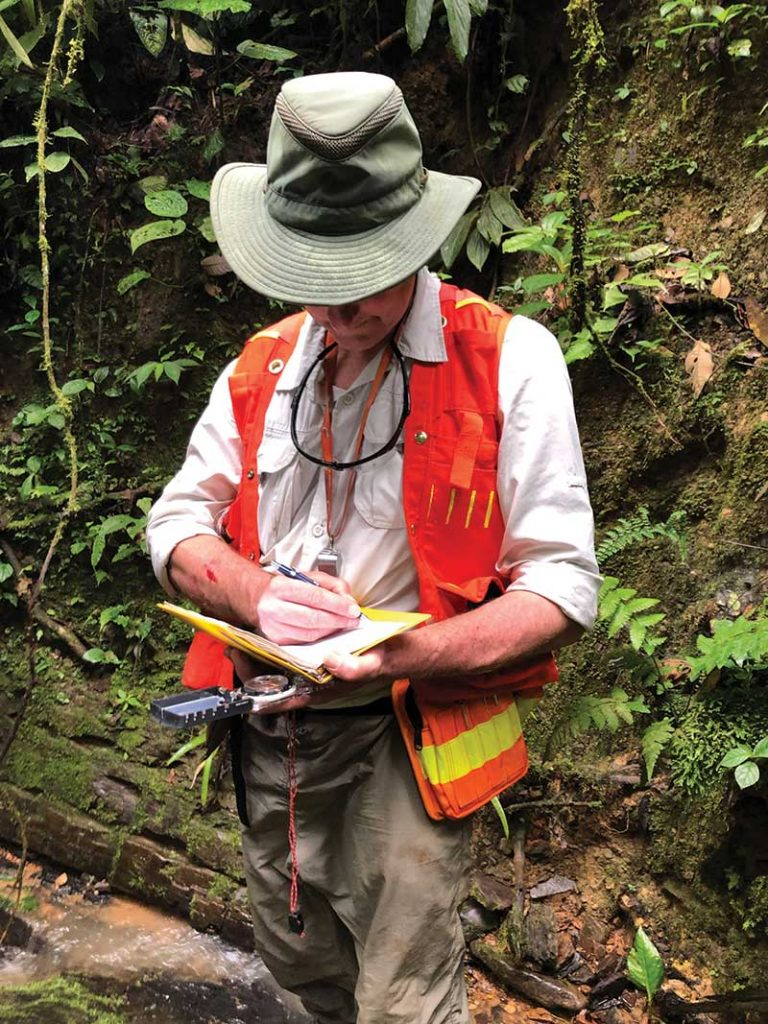 Aurania Resources president Richard Spencer taking notes in the field. Credit: Aurania Resources.