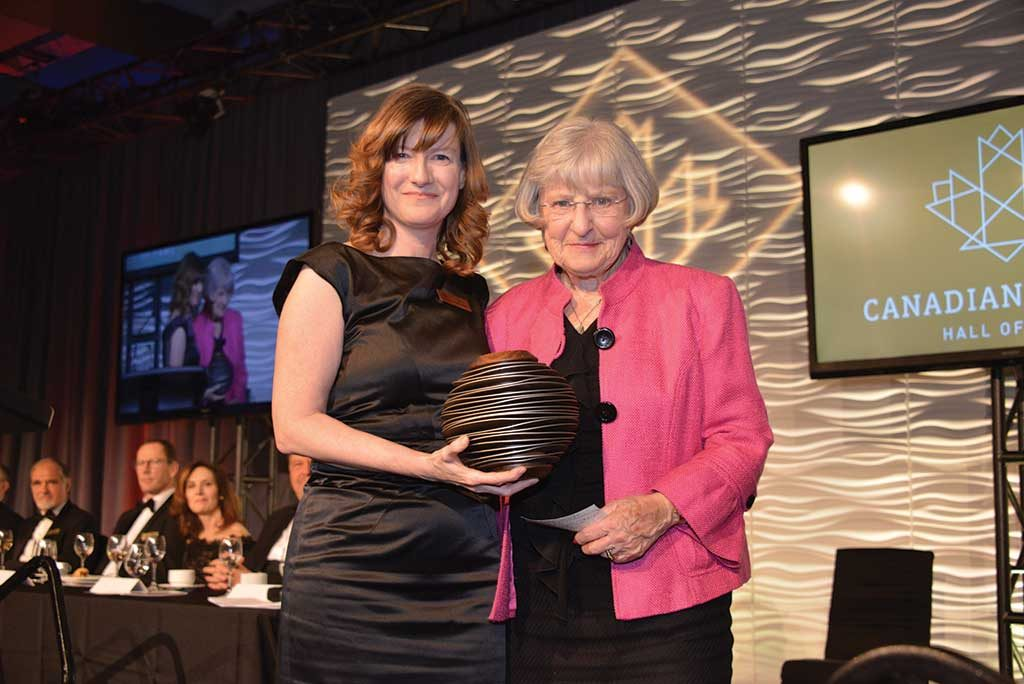 Lisa McDonald (left), PDAC executive director, presenting to Janet Meikle (widow of Brian Meikle). Photo by Keith Houghton.