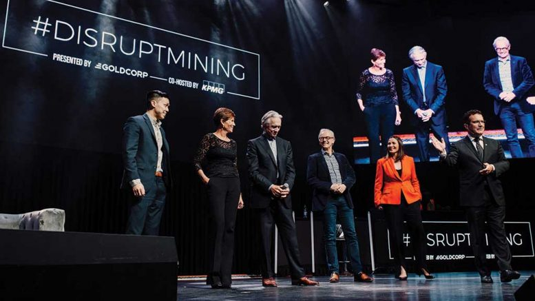 The judging panel and host on stage in Toronto at Goldcorp and KPMG's #DisruptMining innovation challenge in March 2019, from left: Jacob Yeung, student and captain of the University of British Columbia #DisruptMining judging team; Sue Paish, CEO of Canada's Digital Technology Supercluster; Ian Telfer, chair of Goldcorp; Wal van Lierop, founder and managing partner of Chrysalix Venture Capital; Katie Valentine, global head of mining consulting at KPMG; and Rick Mercer, master of ceremonies. Credit: Goldcorp.