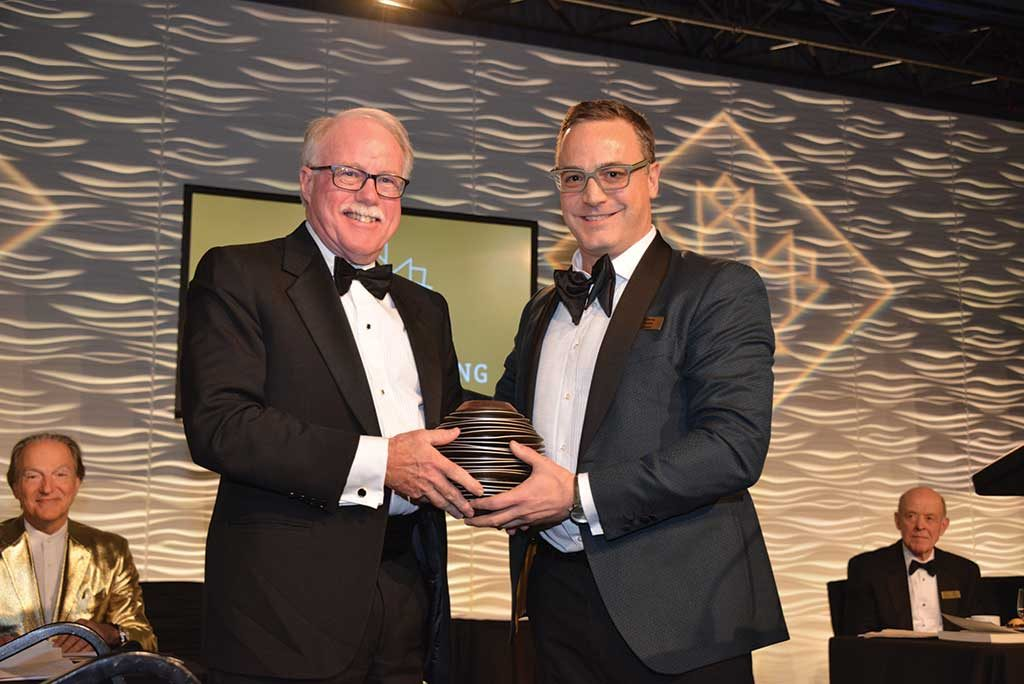 Northern Miner Group publisher and CMHF director Anthony Vaccaro (right)presenting to James Gill. Photo by Keith Houghton.