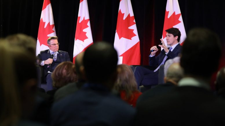 Canadian Prime Minister Justin Trudeau (right) being interviewed by outgoing PDAC president Glenn Mullan at the annual convention of the Prospectors and Developers Association of Canada in Toronto on March 5, 2019. Credit: Government of Canada.
