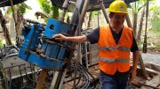 Salazar Resources founder, president and CEO Fredy Salazar with a drill rig in 2018 at the Curipamba VMS project in Ecuador. Adventus Zinc is earning a 75% stake in the project. Credit: Salazar Resources.