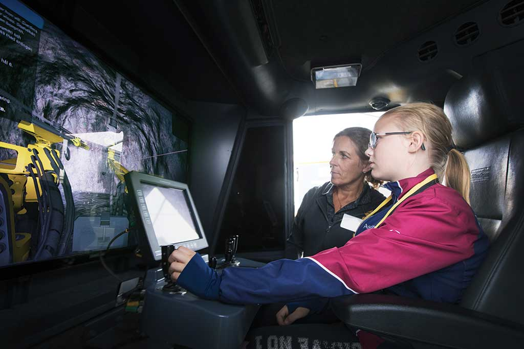The third-place photo shows a girl using a drilling simulator at Lundin Mining's Zinkgruvan mine in Sweden. Credit: Lundin Mining.