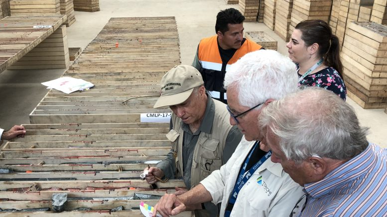 Toachi Mining board members Ebe Scherkus and Laurie Curtis reviewing core with Dr. Mike Druecker (from right to left) at a core facility in the village of Palo Quemado, Ecuador. Credit: Toachi Mining Inc.