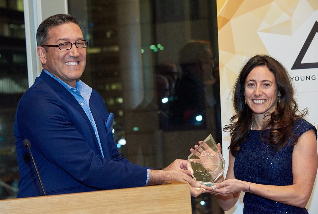 George Salamis, president and CEO of Integra Resources, presents the YMP's Eira Thomas Award for 2018 to Andrée St-Germain, chief financial officer of Integra Resources. Credit: YMP.