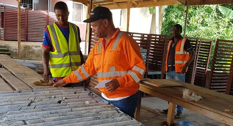 Employees study drill core at Thor Explorations' Segilola gold project in Nigeria. Credit: Thor Explorations.