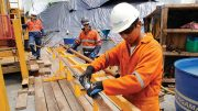 Drillers handle core at the Cascabel project. Credit: SolGold.