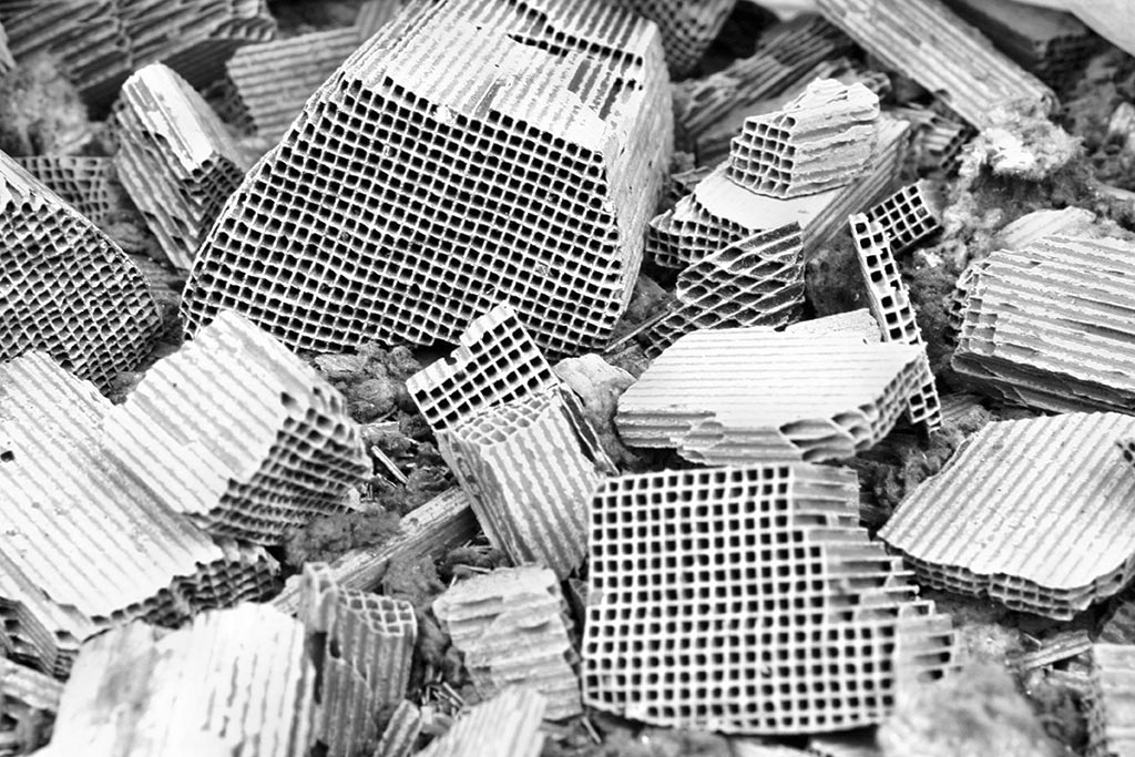 Salvaged cores from automobile catalytic converters. The honeycomb structures are often coated with palladium and other precious metals. Credit: Istock/ Adam88xx.