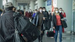 Travellers at Beijing Capital International Airport in January 2020. Credit: XiFotos/iStock.